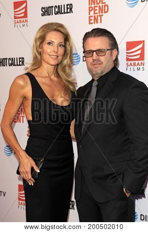 LOS ANGELES - AUG 15:  Ric Roman Waugh, wife Tanya at the