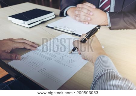 Closeup of businessman applicant writing application form person completing filling information job interview hiring concept.