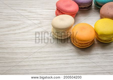 Colorful Macaron sweet and delicious on white wooden with copy space.