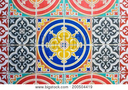 Colorful Vintage style floor tile pattern texture and background. Abstract pattern background over seventy years old tiles for floors and walls.