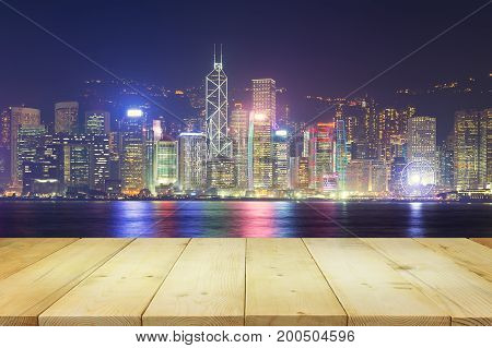Cityscape and skyline at Victoria Harbour in Hong Kong city at night time.