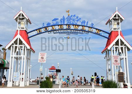 OCEAN CITY, MARYLAND - JUL 1: The famous Boardwalk sign in Ocean City, Maryland, as seen on July 1, 2017. The city It features miles of beach and a wooden boardwalk lined with restaurants, shops and hotels.