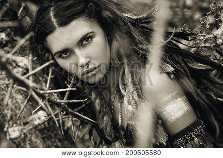 wild amazon woman portrait with tree thorns