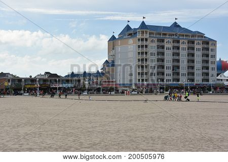 OCEAN CITY, MARYLAND - JUL 1: The famous Boardwalk in Ocean City, Maryland, as seen on July 1, 2017. The city It features miles of beach and a wooden boardwalk lined with restaurants, shops and hotels.