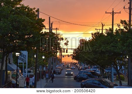 OCEAN CITY, MARYLAND - JUL 1: Sunset in Ocean City, Maryland, as seen on July 1, 2017. The city features miles of beach and a wooden boardwalk lined with restaurants, shops and hotels.