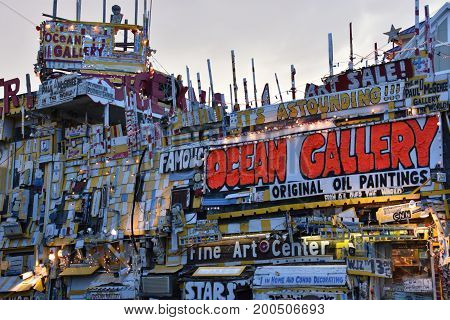 OCEAN CITY, MARYLAND - JUL 1: Ocean Gallery Poster World at Ocean City, Maryland, as seen on July 1, 2017. The city It features miles of beach and a wooden boardwalk lined with restaurants, shops and hotels.
