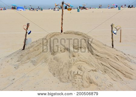 OCEAN CITY, MARYLAND - JUL 1: Sandcastle in Ocean City, Maryland, on July 1, 2017. The city It features miles of beach and a wooden boardwalk lined with restaurants, shops and hotels.