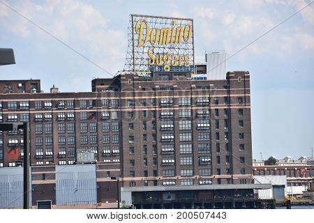 BALTIMORE, MARYLAND - JUL 2: Domino Sugar Factory in Baltimore, Maryland, as seen on July 2, 2017. Domino is the last major manufacturer still operating in Baltimore's Inner Harbor.