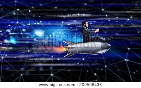 Fast internet concept with a businessman over a speedy rocket