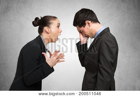 Angry woman shouting to a man