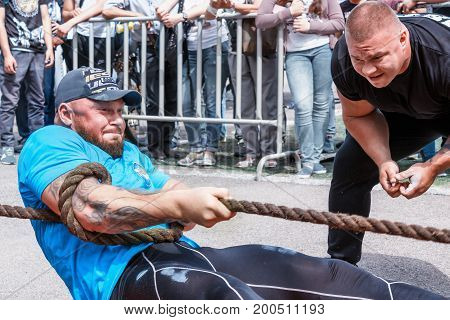 Almaty , Kazakhstan - May 28, 2017. Strong man pulls the rope. City fesitwal sport on the street for a healthy lifestyle.