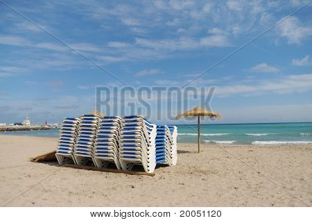 Beach Lounge Chairs Stacked Umbrella