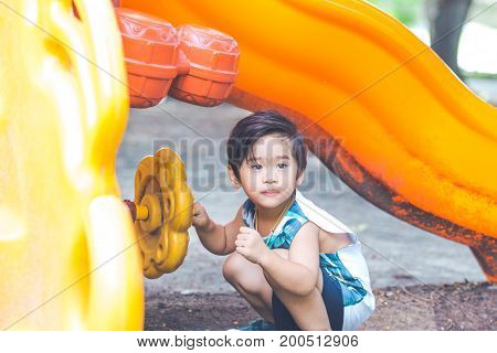 Asian Cute Boy Is Playing In The Playground.
