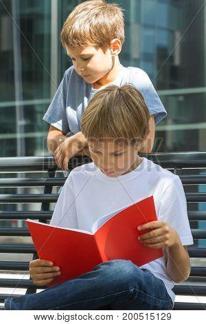 Kids doing homework outdoors. Back to school concept.