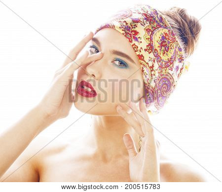 young pretty modern girl with bright shawl on head emotional posing isolated on white background, asian people ethnicity