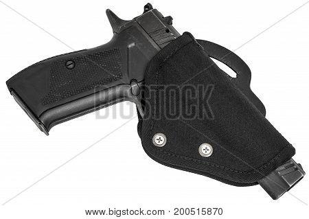 Handgun in the nylon holster. Isolated background