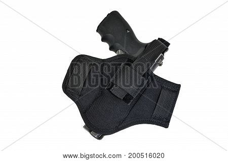 Handgun in the nylon holster. Isolated background