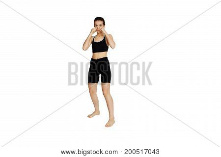 Beautiful agressive girl is boxing to camera.