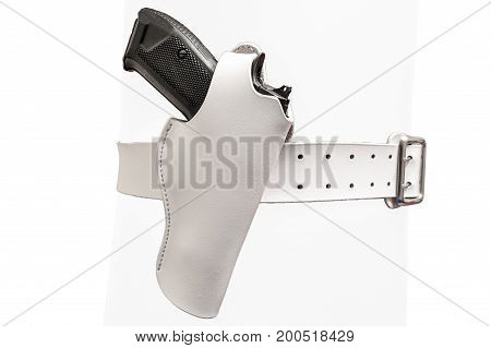 White leather two prong belt with a gun in a molded holster close up isolated