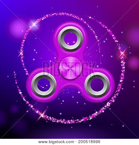 Purple colorful spinner on an abstract background with purple luminous backdrop. Abstract background with purple luminous backdrop. Modern children's purple toy - spinner.