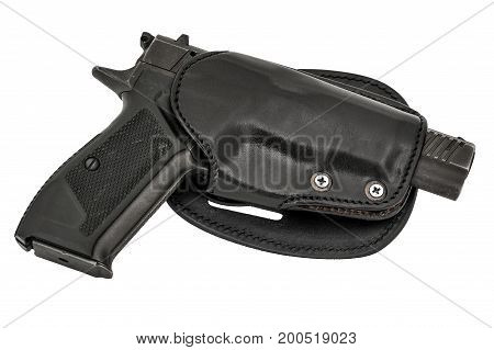 Molded leather holster with handgun isolated on white background.
