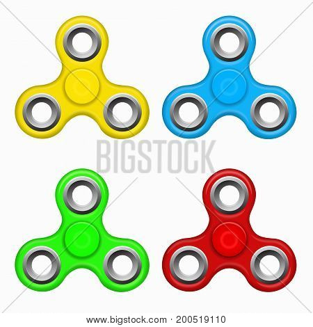 Hand fidget spinner toy - stress and anxiety relief. Yellow, red. blue, green colorful spinner on a white background. Modern children's toy - yellow, red. blue, green spinner.