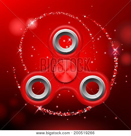 Red colorful spinner on an abstract background with red luminous backdrop. Abstract background with red luminous backdrop. Modern children's red toy - spinner.