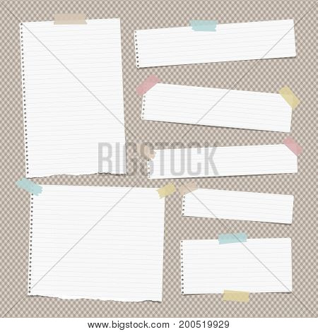 White ruled, lined ripped note, copybook, notebook paper strips stuck with colorful sticky, adhesive tape on brown squared background