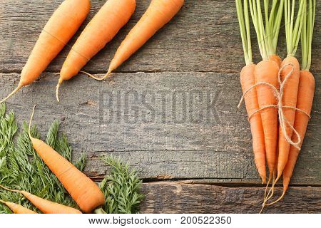 Fresh And Ripe Carrots On Wooden Table