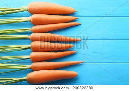 Fresh And Ripe Carrots On Blue Wooden Table