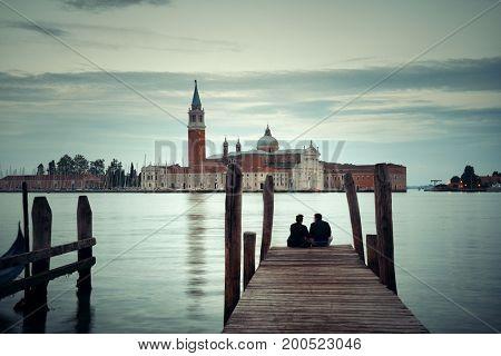 Lovers in front of San Giorgio Maggiore church in Venice, Italy.