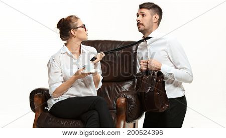 The young man and beautiful woman in business suits at office isolated on white background. Concept of boss and subordinate