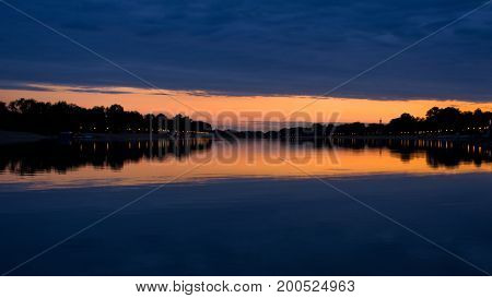 Evening clouds and its reflection in a lake Ada, Belgrade, Serbia
