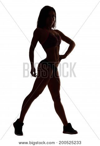 Silhouette of a sexy sportswoman posing isolated on white bodybuilding working out exercising sport motivation concept.