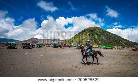 JavaIndonesia-Arpil 242017 : A horseman at Mount Bromo of Bromo-Tengger-Semeru National Park in Indonesia.