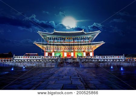 Gyeongbokgung palace and full moon at night in Seoul South Korea.