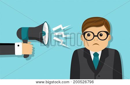 Sad tired businessman stands, and someone scolds a businessman in a megaphone