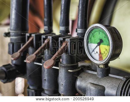 Old abandoned pressure transmitter mechanism close up.