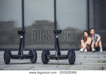Teenage Couple With Gyro Scooters