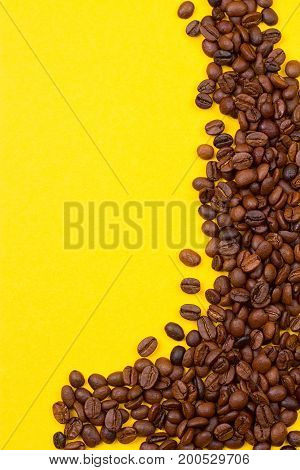 Coffee Background. roasted coffee beans on yellow background