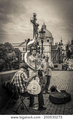 PRAGUE, CZECH REPUBLIC - AUGUST 16, 2017: Street musicians on Charled bridge in the center of Prague, Bohemia