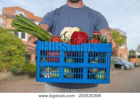Man Is Delivering Groceries To The Customer.