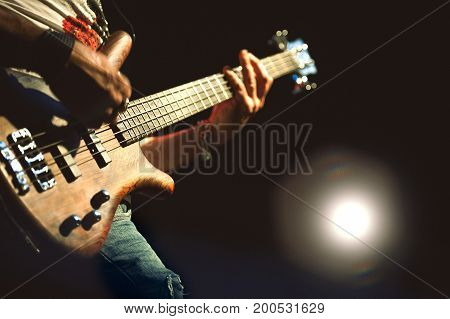Electric Bass played during a concert in outdoor