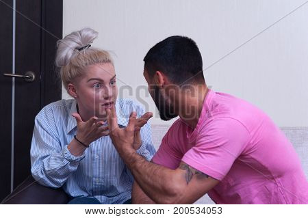 Family or couple conflict. Angry man and woman shouting to each other. Quarrel between husband and wife.