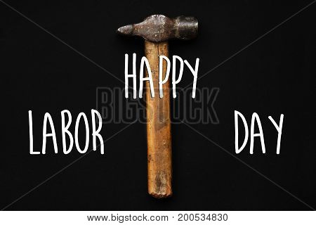 Happy Labor Day Text Sign. Hammer, Tool For Repairing And Renovation Concept On Black Background Top