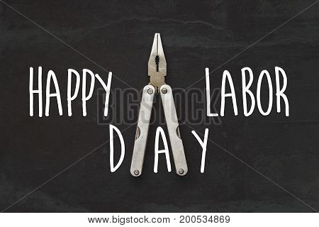 Happy Labor Day Text Sign. Pliers, Tool For Repairing And Renovation Concept On Black Background Top