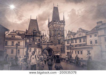 PRAGUE, CZECH REPUBLIC - AUGUST 16, 2017: Monochrome view of Prague. Tourists walking on the Charles Bridge at sunset, Bohemia