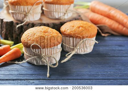 Delicious carrot muffins on wooden table