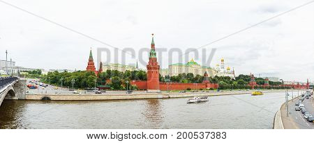 Panorama view of Kremlin in cloudy summer day. Famous landmark in historical center of Moscow. Russia.