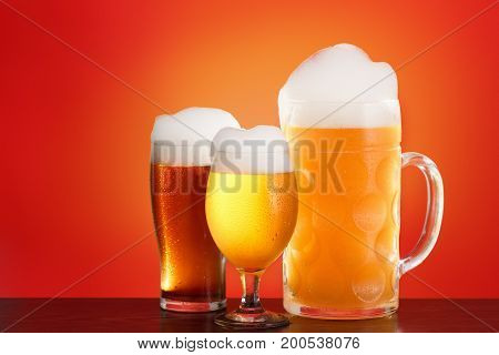 Mug and wine glass of beer on red background. Octoberfest design for Wiesn fest.